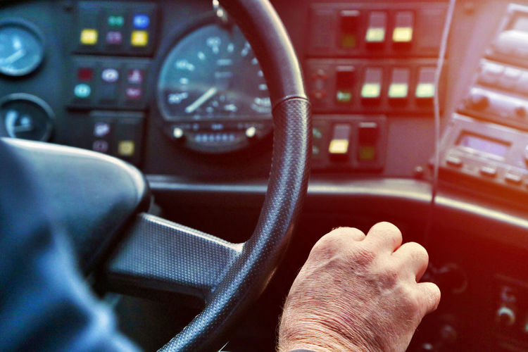 Cropped hand of man driving vehicle