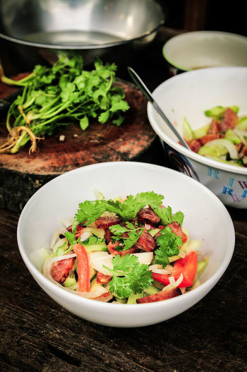 High angle view of vegetable salad in bowl on table