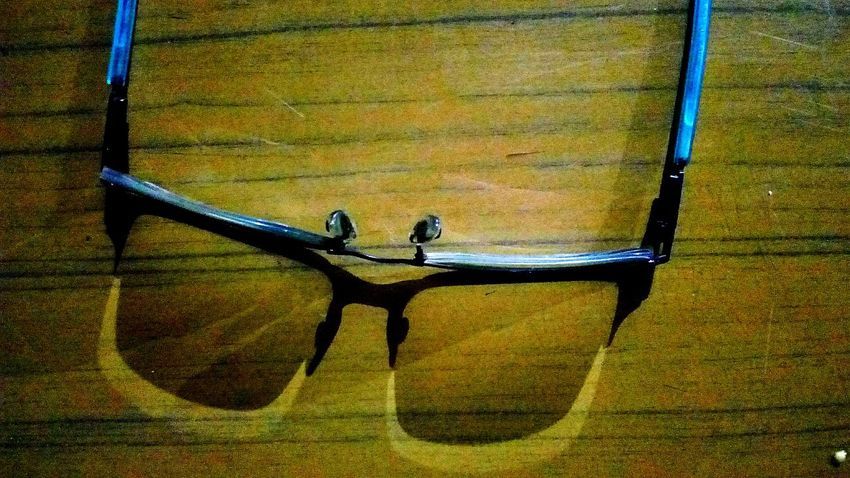 👓 glasses and shadow Mobilephotography SSClickpix SSClicks SSClickPics Night Time Photography Glass Aqua Shadow Shadow Like Real Real Like Shadow SSClickPics SSClicks SSClickpix Desk Brown Yellow Colour
