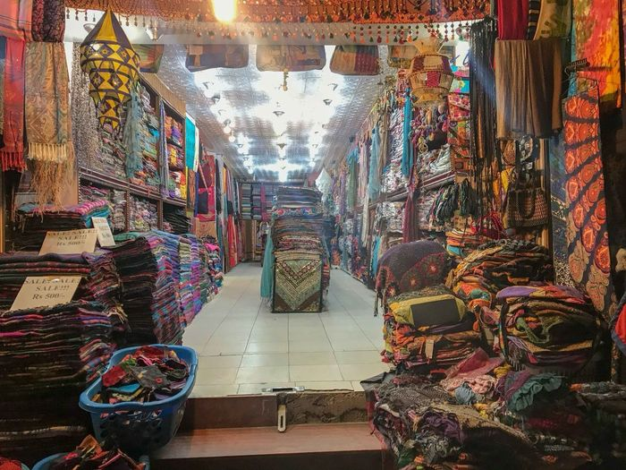 Carpet store in Thamel, Kathmandu Nepal Architecture Illuminated Indoors  Large Group Of Objects Market Multi Colored Retail Display Shopping Small Business Textile