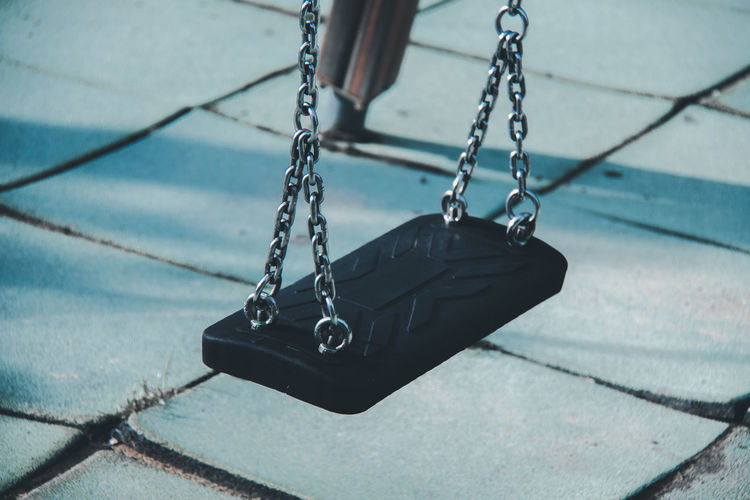 Empty swing hanging at playground