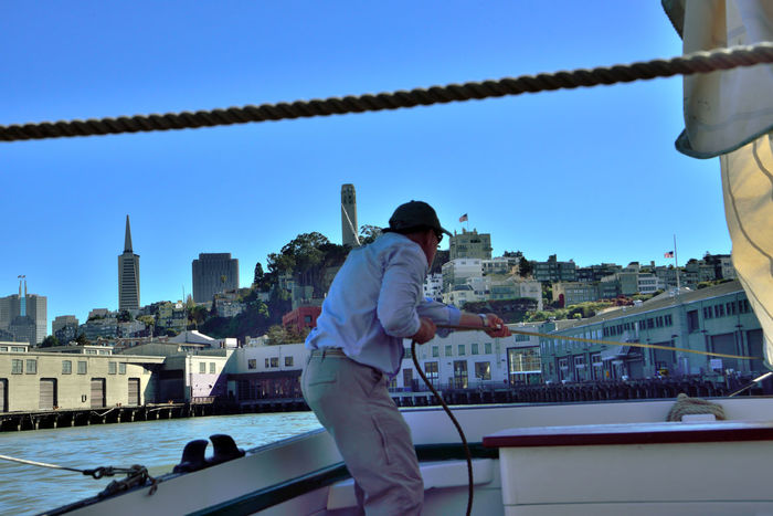 Sailing The Bay 19 Aboard The Alma Sailing San Francisco Bay San Francisco Skyline Deck Side Deckhand Lowering The Sails Harbor Fort Mason Fisherman's Wharf Waterfront Cityscape Transamerica Pyramid Building Coit Tower Hilltop Urban Photography Close-up Clear Blue Sky Warehouses City View  Landscape_Collection Landscape_photography