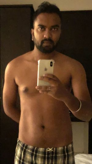 iPhone X Indianphotography IPhone One Person Standing Adult Indoors  Waist Up Men Mid Adult Shirtless Front View Facial Hair Real People Beard Mid Adult Men Technology Lifestyles Males  Chest Holding Three Quarter Length
