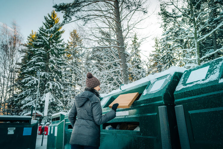 Females Woman Cardboard Cold Temperature Garbage Holding Lifestyles Nature One Person Outdoors People Real People Recycling Recycling Center Snow Social Issues Standing Tree Warm Clothing Waste Management Wellpaper Winter
