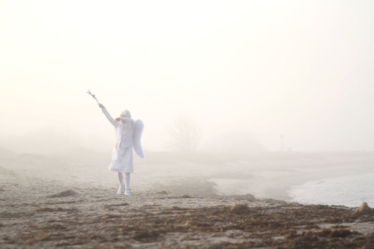 Christmas Dress Heaven Light Nature Shades of Winter Sunlight Angel Arms Raised Beach Beauty In Nature Copy Space Costume Wing Day Engel Fog Freedom Girl Human Arm Land Nature One Person Outdoors Standing White
