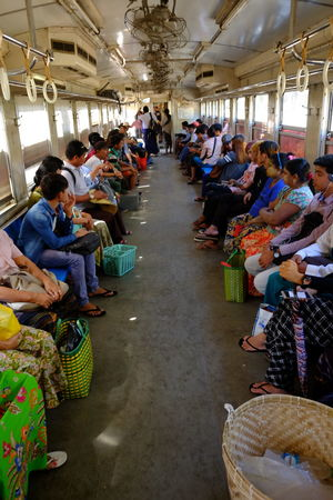 Inside Carriage of Yangon Circular Train Ceiling Fans City City Life City Lifestyle Composition Crowd Daylight Full Frame Full Length Full Of People Indoor Photography Large Group Of People Multi Coloured Myanmar Public Transport Public Transportation Real People Side By Side Traditional Clothing Train Carriage Travel Destination Travelling Public Yangon Yangon Circular Railway Yangon Circular Train