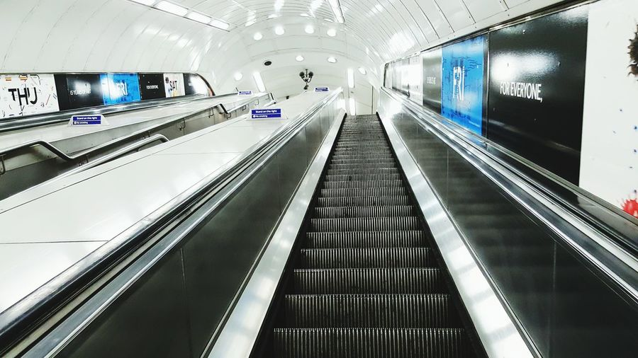 London Tube Tube Station  Escalators Transportation Mode Of Transport Indoors  Public Transportation Technology The Way Forward Modern Illuminated On The Move Escalator High Angle View Way Up Built Structure TravelConnection Convenience Architecture Diminishing Perspective