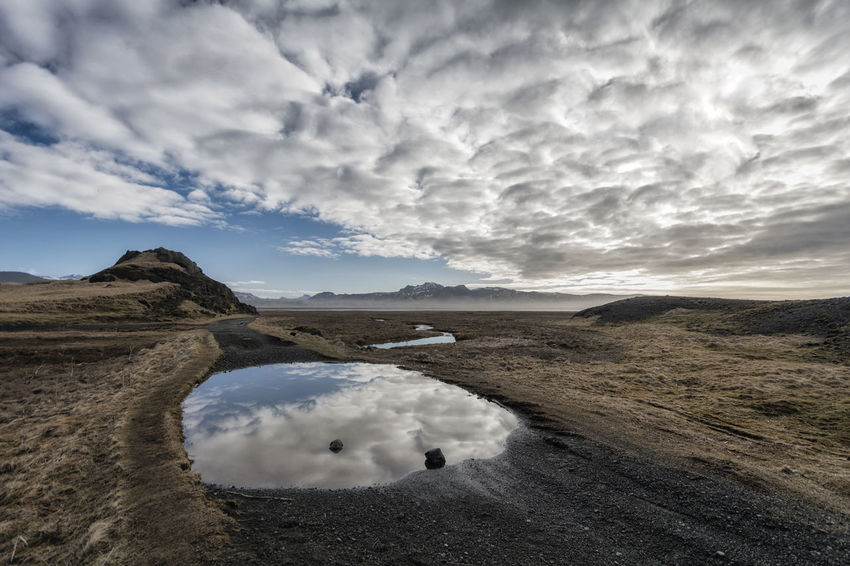 Landscape in Iceland Beauty In Nature Cloud Cloud - Sky Cloudy Day Horizon Over Land Idyllic Landscape Mountain Nature No People Non Urban Scene Non-urban Scene Outdoors Overcast Remote Scenics Sky Tourism Tranquil Scene Tranquility Weather
