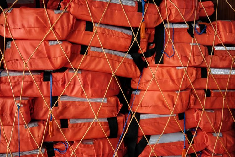 Lifejackets stacked Life Buoy In The Boat Boat Security Life Vest Rescue Stacked Safety Group Lifejackets
