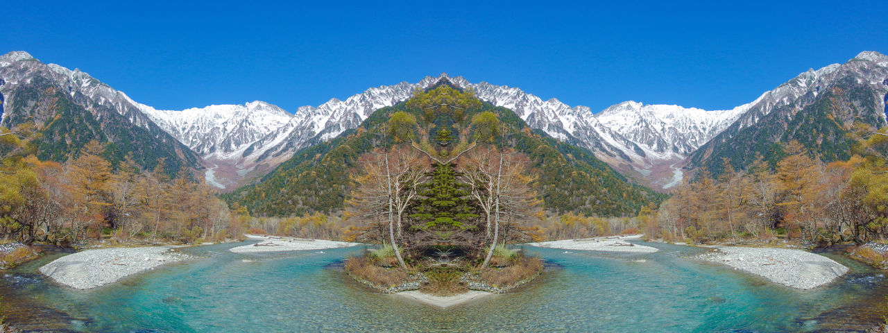 natural Japanese alps mountain at kamikochi nagano japan Japan Alps Beauty In Nature Blue Blue River Clear Sky Day Kamikochi Lake Mountain Mountain Peak Mountain Range Nagano Nature No People Plant Scenics - Nature Sky Snow Tranquility Travel Destinations Tree Water