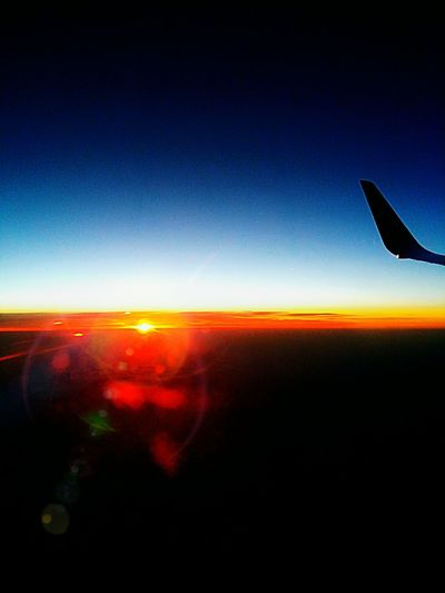 Flying Airplane Journey Sky Transportation Sunset Travel Air Vehicle Mid-air Aerial View Landscape Silhouette Nature Travel Destinations Aerospace Industry Clear Sky Horizon Plane Planet Earth Planes Planespotting Planes In The Sky Plane Window Planeview Horizon Over Sea