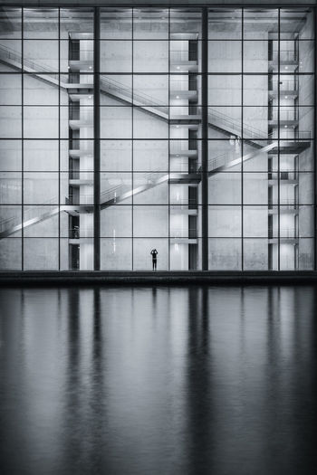 Reflection of man in airport