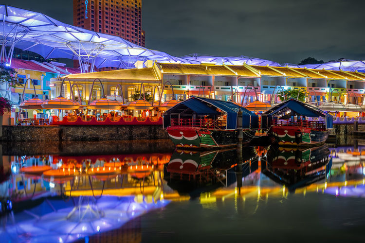Reflection of illuminated buildings in water at night