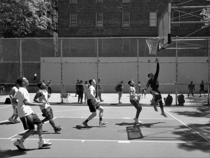 Men Playing Basketball At Court