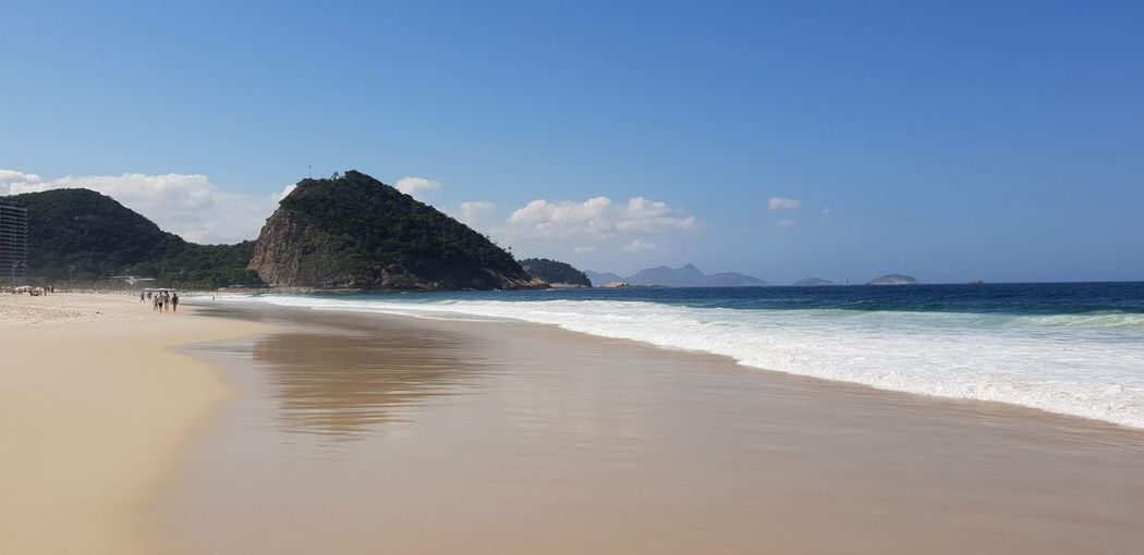 Rio de Janeiro Water Sky Sea Land Beach Beauty In Nature Scenics - Nature Outdoors Non-urban Scene Clear Sky Copy Space Tranquility Tranquil Scene Sand Day Nature Idyllic Blue No People Mountain