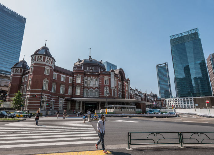 People walking in front of tokyo station against clear sky