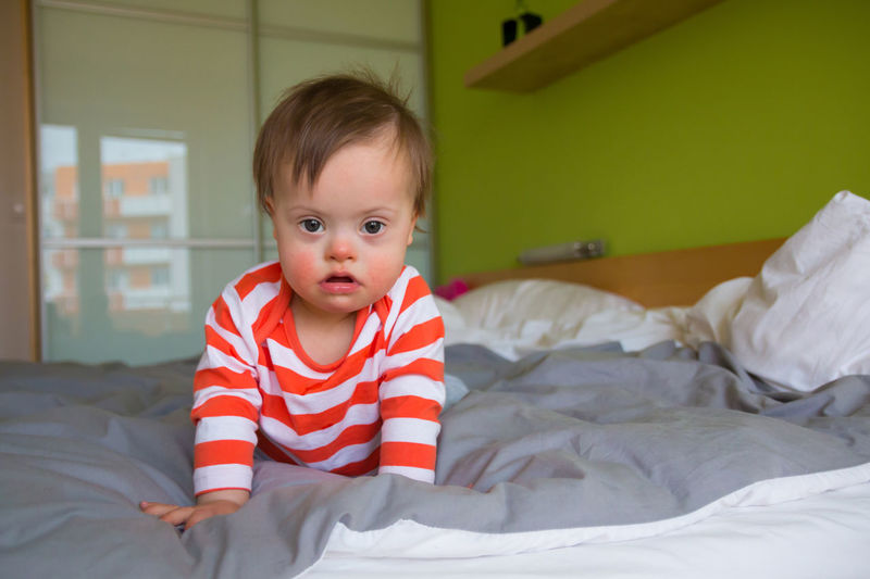 Babyboy Bed Bedroom Childhood Cute Day Down Syndrome Downsyndrome Home Interior Illness Indoors  Innocence Lifestyles Looking At Camera Mental Health  One Person People Portrait Real People