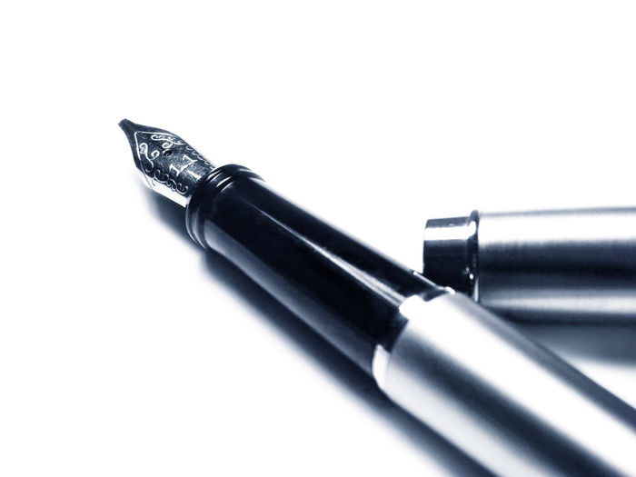 fountain pen, close up shot, isolated on white background. Isolated Black Color Close-up Copy Space Cut Out Equipment Fountain Pen Fountain Pen Nib High Angle View Indoors  Ink Isolated White Background Metal Nib No People Pen Selective Focus Silver Colored Single Object Steel Still Life Studio Shot Two Objects White Background Writing Instrument