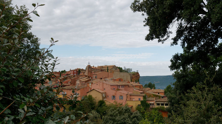 Provence France Ocher Ocher Color Outdoors Cloud - Sky Sky Sky And Clouds Tree Forest Village Village Photography Cityscape TOWNSCAPE Old Town Colorful Colorful Houses Architecture Architecture_collection Façade Building Built Structure City Building Exterior Nature Plant Town Location Place Residential District House No People Exploration Day Growth Roof
