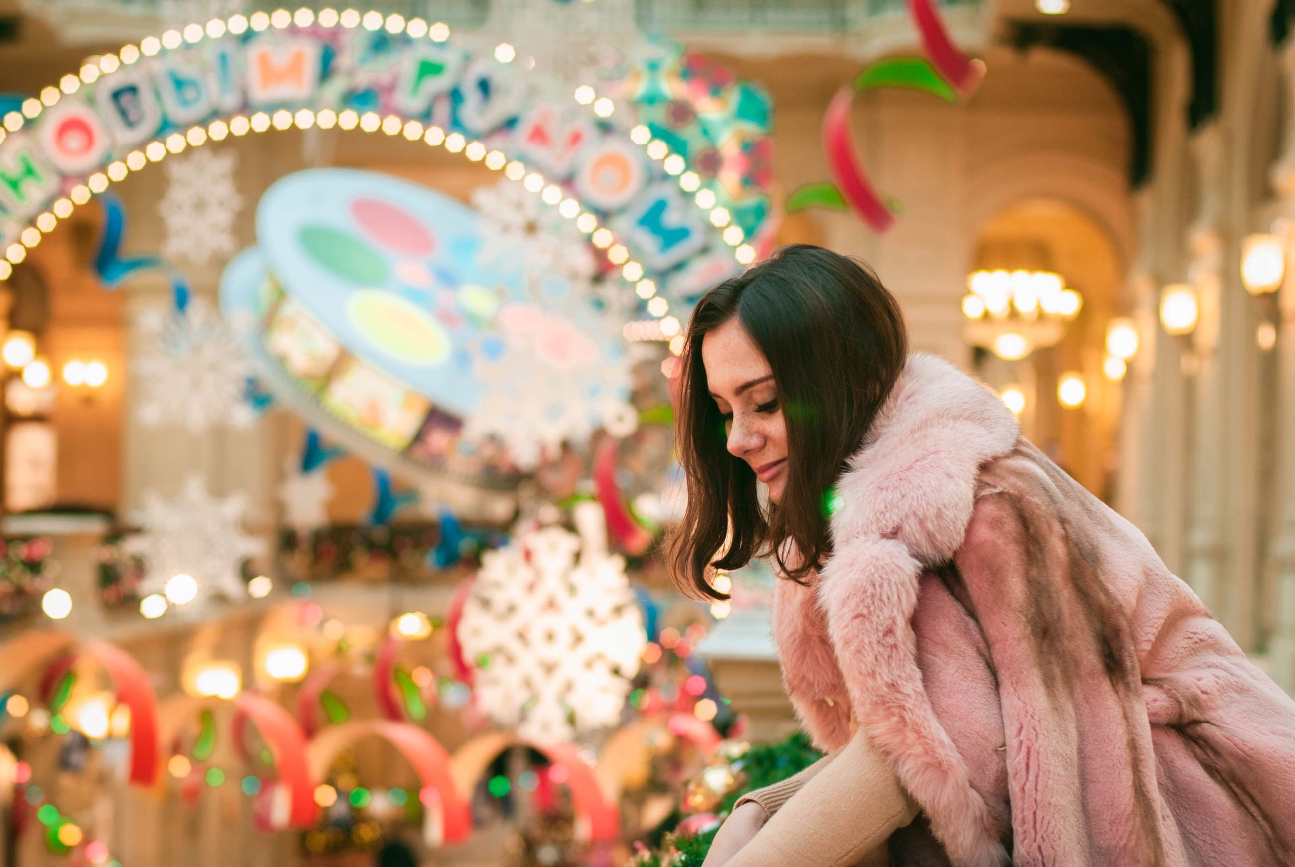 leisure activity, women, illuminated, focus on foreground, young adult, one person, amusement park, real people, adult, emotion, happiness, amusement park ride, lifestyles, young women, smiling, enjoyment, portrait, clothing, side view, hairstyle, warm clothing