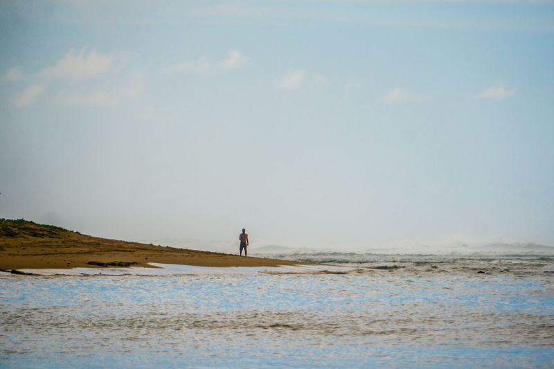 A man walks along the beach near Tunnels, Kauai, Hawaii. Beach Beauty In Nature Day Horizon Over Water Lifestyles Men Nature One Person Outdoors People Real People Scenics Sea Sky Standing Tranquil Scene Tranquility Water