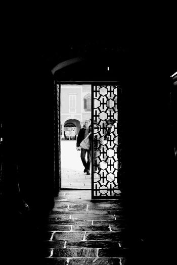 Arch Architectural Column Architecture Black And White Building Built Structure Church Closed Corridor Dark Day Door Doorway Empty Entrance Entrance Illuminated Narrow The Way Forward Walkway Monochrome Photography