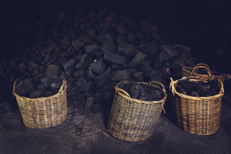 Heap of coals by wicker baskets