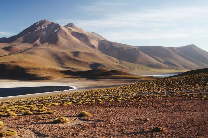 remote isolated Miscanti lagoon Chile Sky Sunlight Tranquility Lake Chile Mountain Beauty In Nature High Altitude Atacama Desert Tranquil Scene Mountain Range Non-urban Scene Cloud - Sky Scenics - Nature Environment Landscape Mountain Peak Formation Arid Climate Climate No People Idyllic Remote Water Nature
