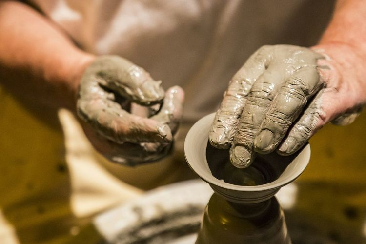 Cropped Image Of Potter Making Pottery