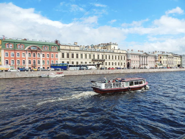 The view from the Engineering bridge on the river Fontanka and embankment in Saint-Petersburg, Russia. Architecture Blue Sky Building Exterior Canal City Cityscape Cloud - Sky Day Gondola - Traditional Boat Mode Of Transport Nautical Vessel No People Outdoors Saint Petersburg Sky Summertime Transportation Travel Destinations Water Water Reflections Waterfront #urbanana: The Urban Playground Summer In The City