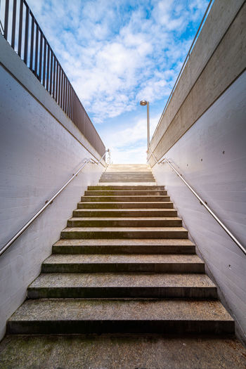 Low angle view of staircase by building against sky