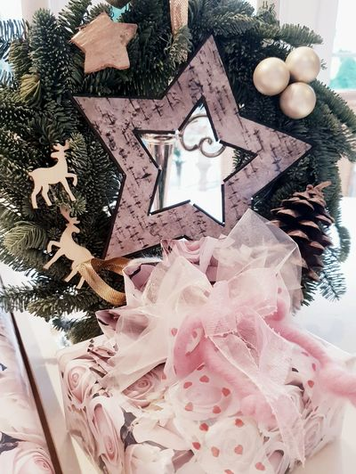 Present infront of Advent wreath. ... Decorative Star Reindeer Adventskranz Advent Wreath Decoration Present Gift Pink Christmas Celebration Close-up Female Likeness Christmas Ornament Christmas Decoration Tied Bow Wrapping Paper Gift Box Christmas Present Birthday Present Bauble Christmas Bauble Generosity Advent