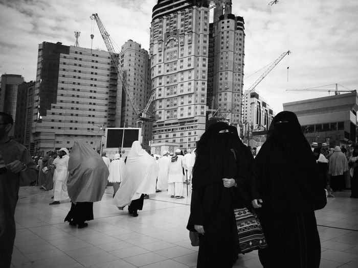 Journey of soul. Business Finance And Industry Skyscraper Women Crowd Black And White Photography Travelogue Catch The Moment Street Photography Traveling The World Black & White People On The Street Makkah Al Mukaramah Journey Of Souls Street Life MeccaStreet Business Woman