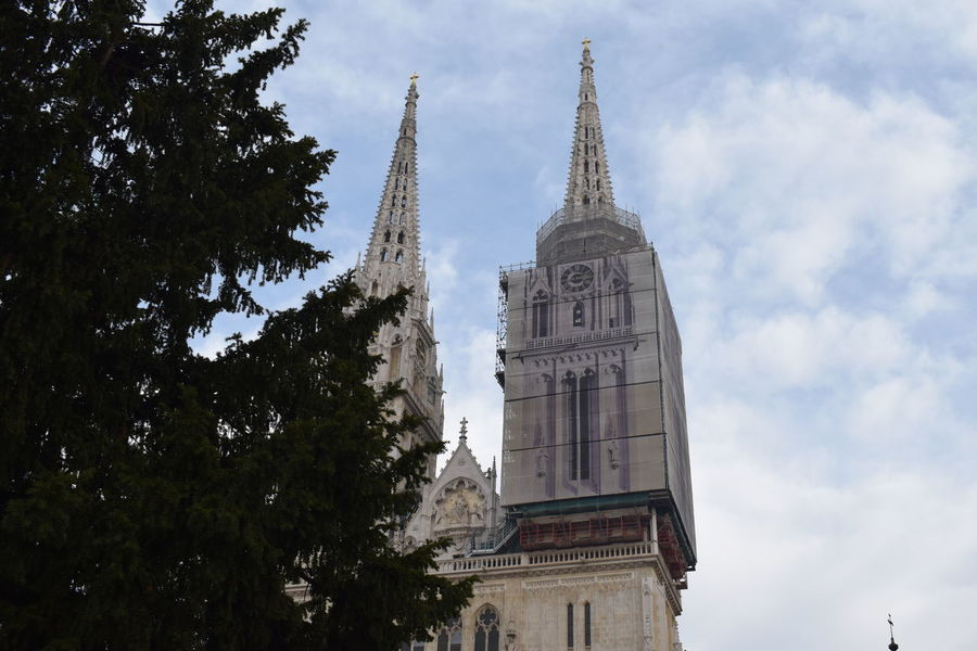 Cathedral Church Croatia EyeEm Gallery EyeEmNewHere EyeEmNewHerе Zagreb Architecture Building Exterior Built Structure Day History Low Angle View No People Outdoors Place Of Worship Religion Sky Sky And Trees Spirituality Tranquil Scene Tree