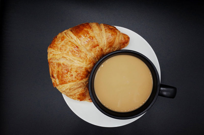 Food And Drink Food Drink Freshness Still Life Refreshment Bread Cup Indoors  Studio Shot Mug Ready-to-eat High Angle View Coffee No People Coffee - Drink Baked Table Close-up Breakfast Meal Black Background French Food Snack Tea Cup