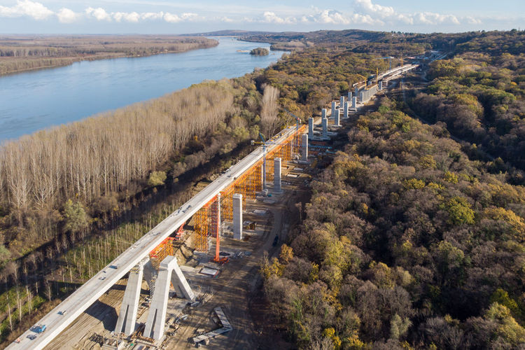Aerial view of bridge construction amidst trees