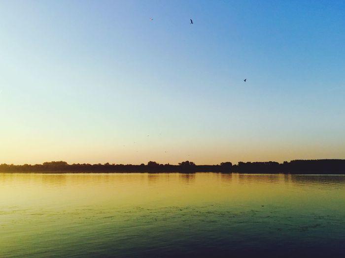 Calm lake against clear sky