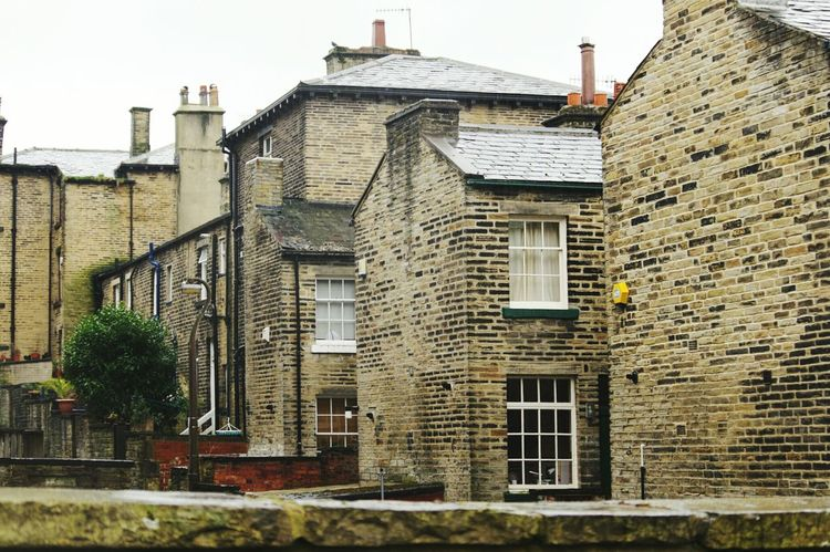 Architecture Building Exterior Built Structure House No People Tree Sky Residential Building Outdoors City Ivy Day Streets Street Photography Rows Of Houses Buildings Monochrome Perspective Yorkshire POV Cobblestone Streets Bradford Saltaire Architecture Travel Destinations