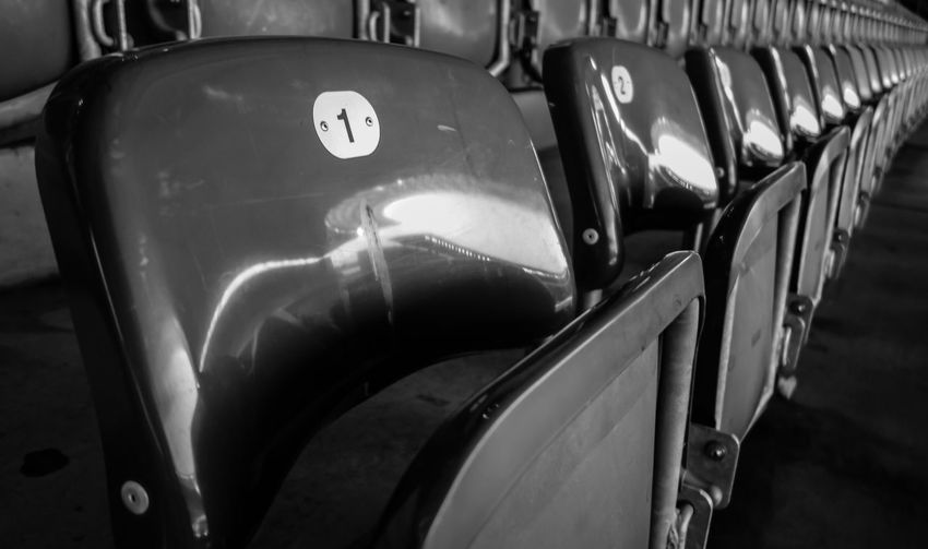 in a row ... B&w Photography Bench Berln Black And White Diagonal Global Photographer Works Exhibition In A Row No People Reflection Seat Seat Bench Sitzbank Sitzen Sitzreihe Stadion Stadium Urban Urban Geometry Urbanphotography Vehicle Seat