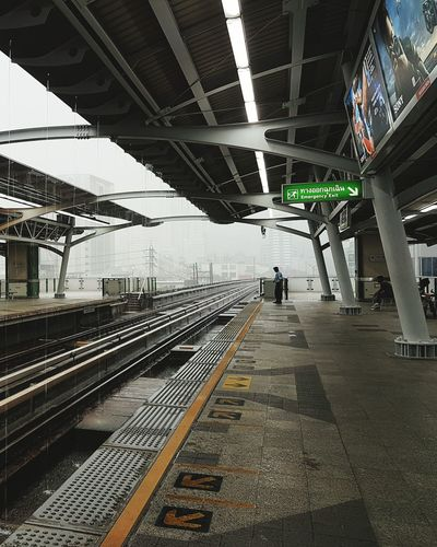 Railroad Track Transportation Railroad Station Platform Railroad Station Public Transportation Rail Transportation Mode Of Transport Travel Built Structure Subway Station The Way Forward Day Arriving Diminishing Perspective Journey Modern No People Public Transport Pathway Bangkok Thailand BTS Raining Lonely City Life