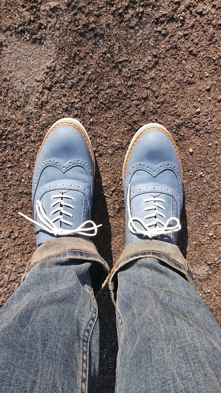 shoe, personal perspective, jeans, low section, one person, human leg, human body part, standing, real people, casual clothing, men, lifestyles, canvas shoe, day, close-up, outdoors, people, adult