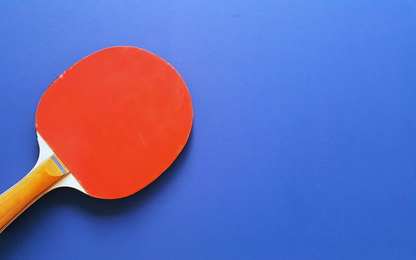 High angle view of table against blue background