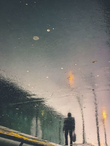 Paris Reflection Water Reflection Water Silhouette Man Alone City Street Streetphotography Buildings Street Lamp Pavement Rainy Day Wet Perspective Urban Geometry Urbanphotography Abstract Light And Shadow Parisian Life Cityscape From My Point Of View Eye4photography  EyeEm Best Edits EyeEmBestPics EyeEm Selects EyeEm Best Shots