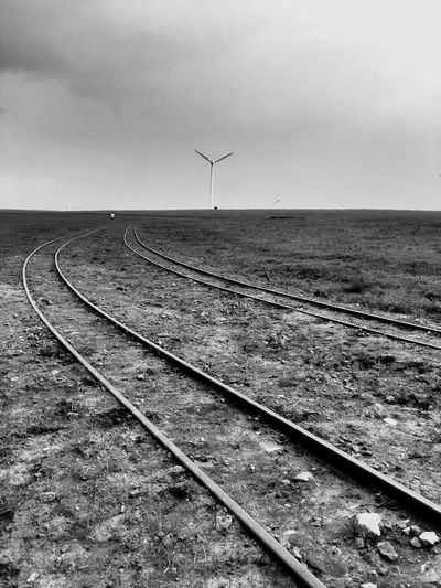 Windmills Grassland Blackandwhite Photography Black And White Photography Black And White Collection  Black & White Blackandwhite Railroad Track Railway Track Train Tracks