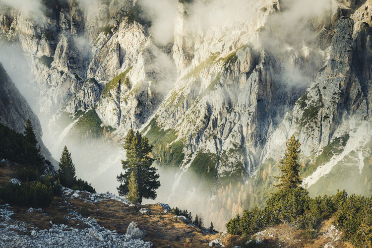 Scenic view of dolomites in foggy weather