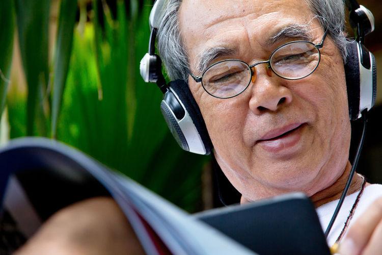 Close-up of senior man using smart phone