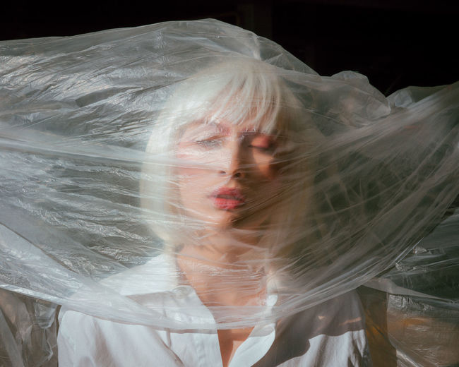 The Creative - 2018 EyeEm Awards The Portraitist - 2018 EyeEm Awards The Still Life Photographer - 2018 EyeEm Awards Adult Beautiful Woman Beauty Black Background Blurred Motion Contemplation Digital Composite Front View Hair Hairstyle Indoors  Lifestyles Motion Newlywed One Person Portrait Real People Transparent Veil White Color Women Young Adult