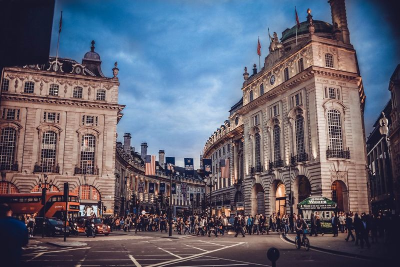 People At Piccadilly Circus During Sunset
