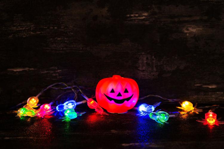 Celebration Halloween Illuminated Creativity Multi Colored Food Food And Drink Jack O' Lantern Pumpkin Spooky Face Decoration Anthropomorphic No People Art And Craft Anthropomorphic Face Holiday - Event Night Glowing Dark