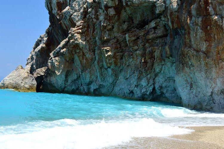 Best beach I've seen so far Lefkada Lefkada Island Sea Sea And Rocks Rock Waves Wave Waves, Ocean, Nature Relaxing Nature Beauty In Nature Summer Summertime Shore Coastline Tourism Cliff Showcase July